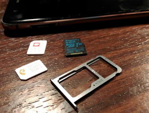 Как одновременно использовать две SIM-карты и карту памяти в смартфоне